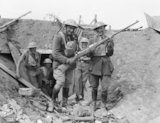 New Zealand gunners in a German emplacement pose with a captured German anti-tank rifle, near Grévillers, 25 August 1918.