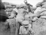 A British soldier fires a machine gun with periscope attachment in the trenches at Gallipoli.