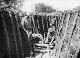 Australian troops repairing a communication trench at Armentieres, May 1916.