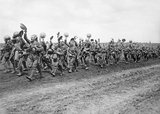 Troops of the 4th Battalion, Worcestershire Regiment (29th Division) marching to the trenches. Acheux-en-Amiénois, Somme, 27 June 1916.
