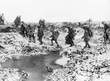 British troops moving up to the forward area over water-logged ground near La Boisselle, Somme, November 1916.