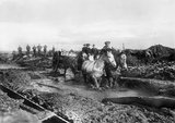 A horse-drawn limber carrying ammunition along the Lesboeufs Road, outside Flers, November 1916.