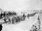 The Black Watch marching back along the Fricourt-Albert road headed by their pipers. Somme, August 1916.