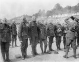 Troops of the Irish Guards at respirator drill. Amiens - Albert road, Somme, September 1916.
