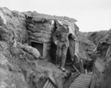 A sniper of the York and Lancaster Regiment comes out of his post in a front line trench at Cambrin, 6th February, 1918.