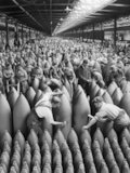Munitions workers paint shells in the National Shell Filling Factory at Chilwell, Nottinghamshire, during the First World War.