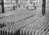 "Rows of 6"" howitzer shells line a warehouse at the National Filling Factory, Chilwell."