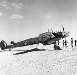 "Captured Messerschmitt Bf 110D ""The Belle of Berlin"" in British markings on a landing ground in North Africa."