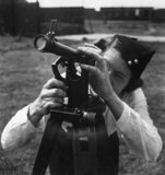 An ATS artillery observer uses a theodolite to measure air shell bursts at the Royal Artillery Experimental Unit, Shoeburyness, Essex , 1942