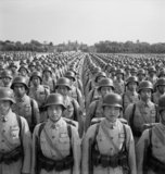 Chinese cadets wearing German pattern steel helmets parade at the Central Military Academy, Chengtu, Szechuan, China, 1944.