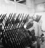 A Chinese soldier checks rifles and bayonet in the armoury of the Military Camp at Chengtu, Szechuan, China, 1944