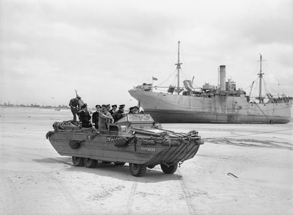 King George VI, accompanied by Admiral Sir Bertram Ramsay and the First Sea Lord, Admiral Sir Andrew Cunningham, touring the beaches at Normandy in a DUKW amphibious vehicle, 16 June 1944.