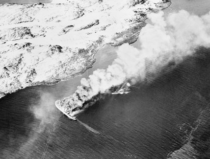 A German troopship burning furiously during an attack by Fairey Barracudas from HMS IMPLACABLE off Norway, 27 November 1944.