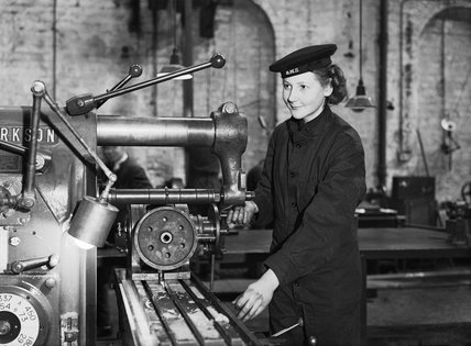 A member of the Women's Royal Naval Service (WRNS) working at a milling machine in the Royal Navy depot at Greenock, 22 March 1943.