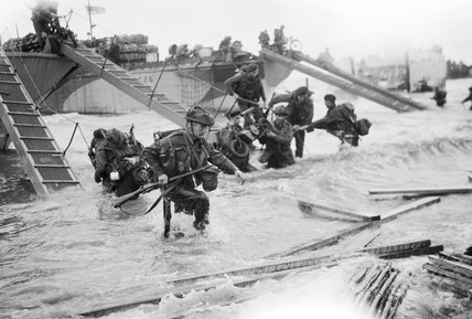 Royal Marine Commandos of headquarters, 4th Special Service Brigade, making their way onto the 'Nan Red' sector of Juno Beach at St Aubin-sur-Mer, on the morning of 6 June 1944.
