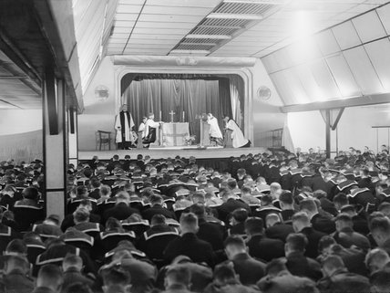 The Archbishop of Canterbury conducts a service in the cinema at Flotta on Orkney during his visit to the Home Fleet at Scapa Flow, 6 September 1942.