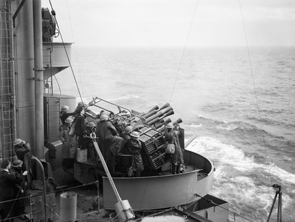 The port eight barrelled Vickers two pounder Mk VIII 'pom-pom' gun in action during anti-aircraft practice on board HMS RODNEY, October 1940.