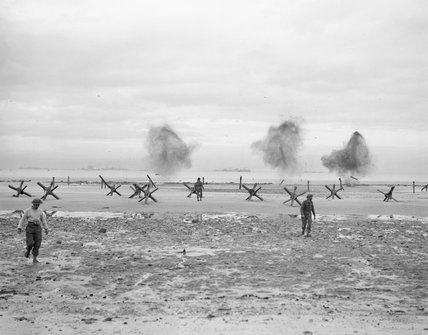 Royal Navy personnel of an ostacle clearance unit blowing up German beach obstacles at La Riviere, Normandy, 9 June 1944.
