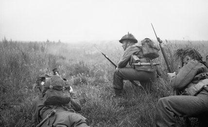 Men of 12 Platoon, 'B' Company, 6th Royal Scots Fusiliers prepare to advance at the start of Operation 'Epsom', Normandy, 26 June 1944.