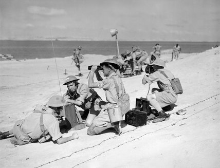 A naval beach party at work during training at HMS SAUNDERS, Kabrit, Egypt, June 1943.