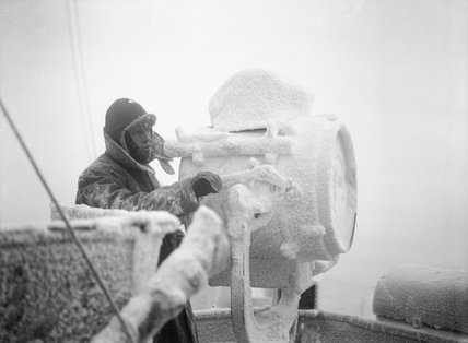 Ice forming on a 20-inch signal lamp on the cruiser HMS SHEFFIELD while escorting an Arctic convoy to Russia, December 1941.