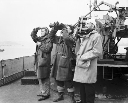 A look-out party clad in winter clothing watching for enemy planes on board the destroyer HMS ATHERSTONE off Plymouth, 7 March 1942.