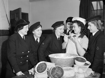 Members of the Women's Royal Naval Service sampling the Christmas pudding at Greenock in Scotland, 19 December 1942.