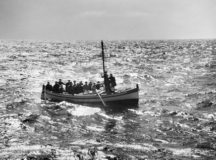 A fishing boat crowded with Italian staff officers and soldiers intercepted by HMS LEMERTON off Cape Bon in Tunisia, May 1943.