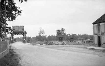 A view of 'Pegasus Bridge' over the Caen Canal at Benouville, 12 July 1944. Two of the Horsa gliders that brought the 'coup de main' force in on the night of D-Day can be seen in the background.