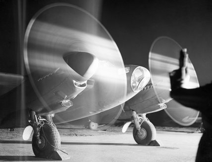 A de Havilland Mosquito PR Mk XVI of No. 140 Squadron RAF warms up its engines at Melsbroek in Belgium, before taking off on a night photographic reconnaissance sortie, 15 February 1945.