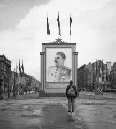 A German civilian looks at a large poster portrait of Stalin on the Unter-den-Linden in Berlin, 3 June 1945.