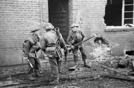 British infantry in action in the streets of Geilenkirchen, Germany, December 1944