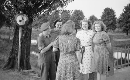 British soldiers chatting to German girls, 16 July 1945.