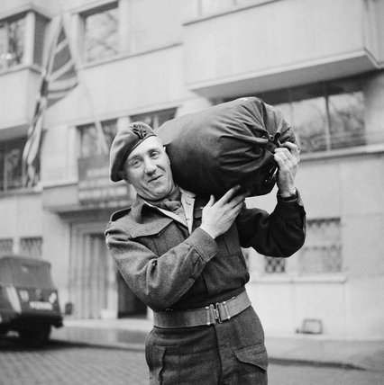 The four millionth British soldier to be demobilised, Rifleman John Neale of the King's Royal Rifles, leaves his unit in Brussels, 9 February 1946.