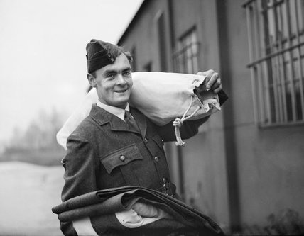 With his full kit having been issued at the Royal Air Force Depot at Uxbridge, new recruit Michael Suthers is ready for posting to an Initial Training Wing, November 1940.