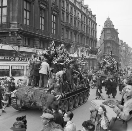 Cheering civilians ride on Cromwell tanks as British troops enter Brussels, 4 September 1944.