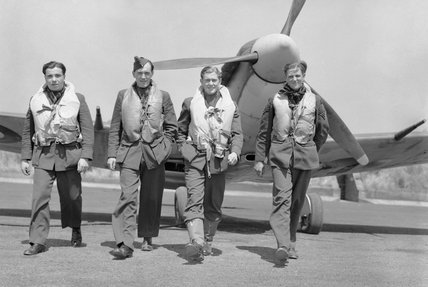 Pilots of No. 611 Squadron walk away from a Supermarine Spitfire Mk V at Hornchurch after a daylight sweep over France, 7 July 1941.