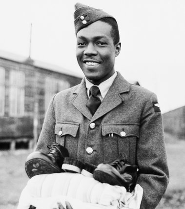 A recruit from the first contingent of RAF ground staff recruited from the West Indies, holding his newly-issued kit at No. 2 Receiving Centre, Cardington, 27 January 1944.