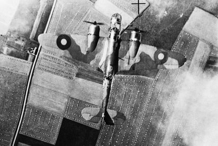 A Bristol Blenheim Mark IV of No. 226 Squadron demonstrates the effectiveness of its camouflage as it flies over the English countryside, 18 August 1941.