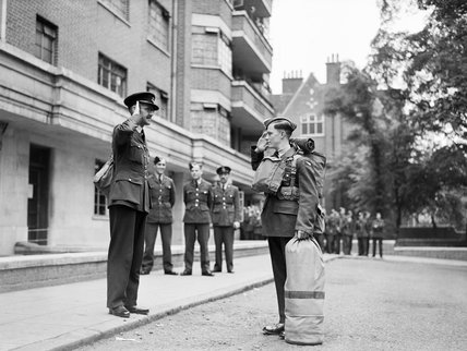 RAF recruit Phillip Fricker salutes his Flight Commander as he departs the Initial Training Wing for aircrew training in South Africa, 2 May 1942.