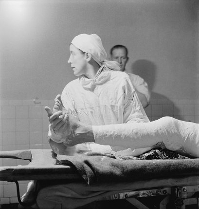 A Cecil Beaton photograph of a British nurse assisting with a leg operation in the General Hospital in Tobruk during 1942.