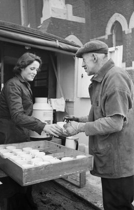 Rachel Bingham of the Women's Voluntary Service (WVS) serves tea from her mobile canteen in London during 1941.