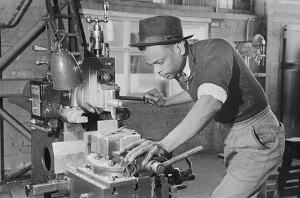Alvin Christie from Jamaica at work in a tank factory in the North of England during the Second World War.