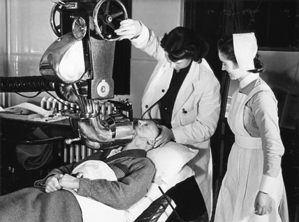 A patient is prepared for radium treatment at a London hospital in 1940.
