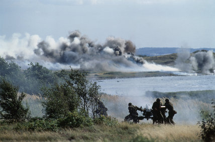 A Danish artillery howitzer firing during NATO Exercise Action Express in Denmark, 1991.