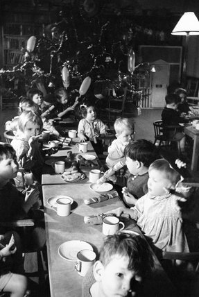 Christmas dinner for children in a home for evacuees at Henley-on-Thames, Oxfordshire, 1941.