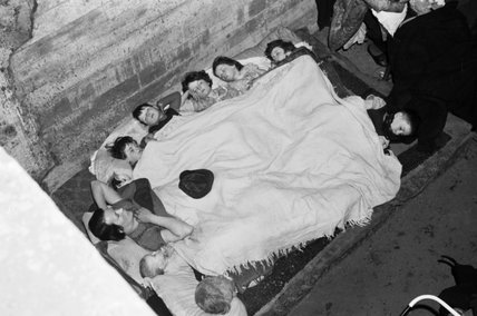 Members of the O'Rourke family sleeping in an air raid shelter under the railway arches in Bermondsey, London during November 1940.