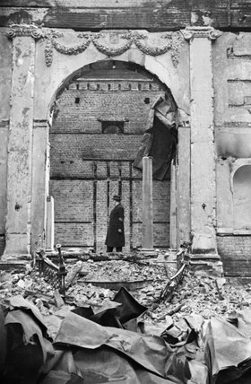 Reverend Hermann Mayerowitsch stands in the runis of the Great Synagogue, Dukes Place, London. The building was extensively damaged during an air raid on 10 May 1941.