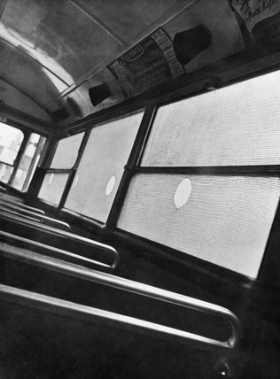View of protective anti-blast mesh fixed on the interior of windows of a London bus in 1941.