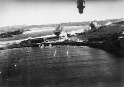 Bombs exploding on the German airfield at Herdla in Norway, during a successful low-level attack by Bristol Blenheims of No. 114 Squadron, part of the Combined Operations raid on Vaagso, 27 December 1941.